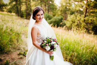 Colorado bride with makeup and floral updo bridal hairstyle by Beauty on Location Studio of Denver