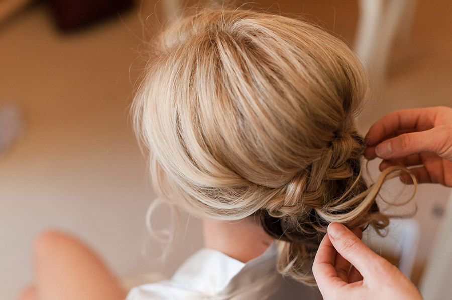 Mobile hair design artist from Beauty on Location Studio styling a Colorado bride