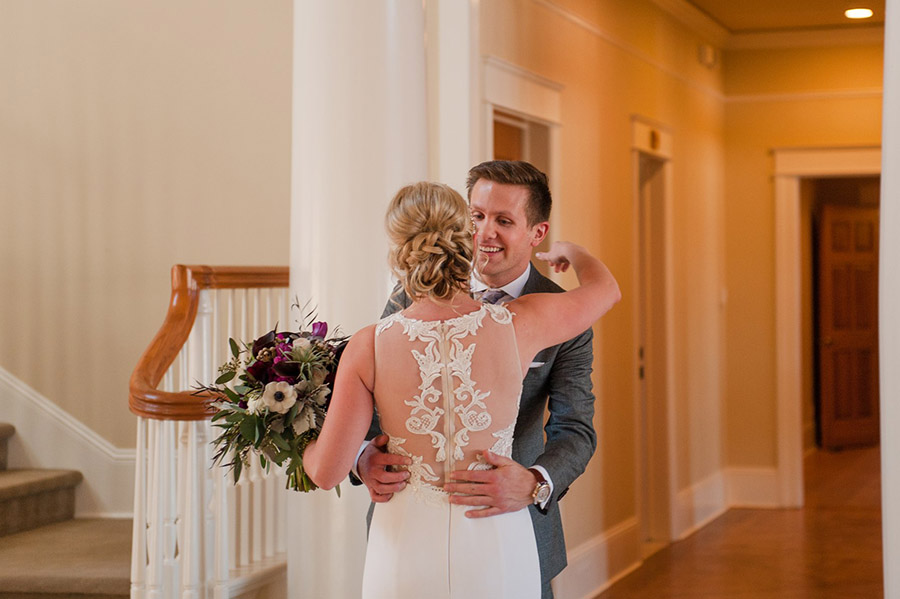 Colorado bride with makeup and braided updo hairstyle by Beauty on Location Studio of Denver embracing her groom