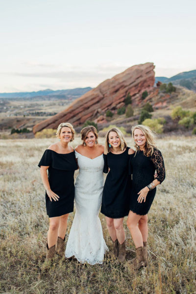 Colorado bride and bridesmaids at Red Rocks with makeup and hair design by Beauty on Location Studio of Denver