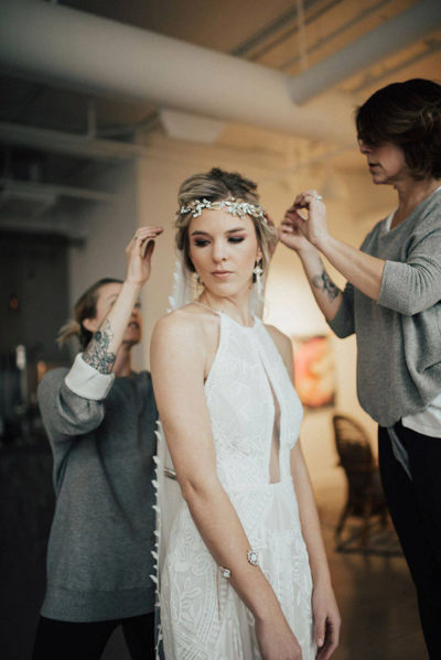 Boho Colorado bride with makeup and updo bridal hairstyle by Beauty on Location Studio of Denver