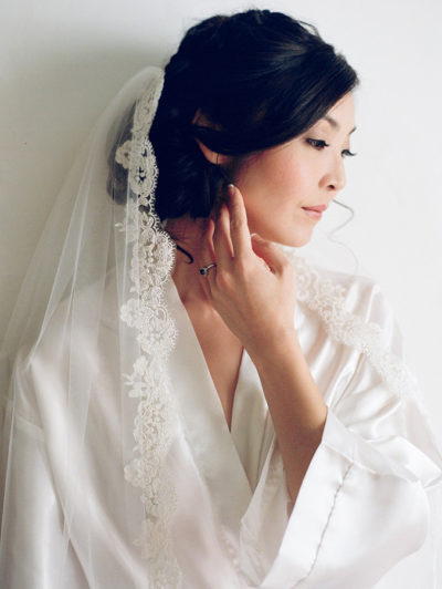Asian American bride with makeup and updo bridal hairstyle by Beauty on Location Studio of Denver