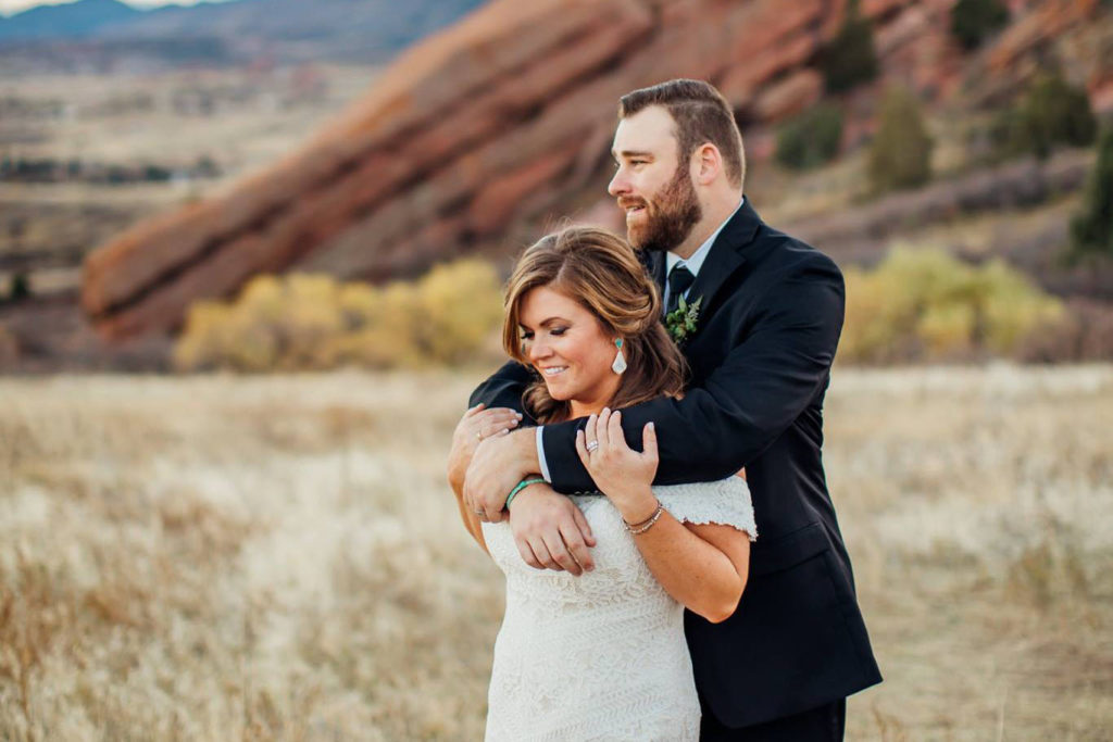 Colorado bride and groom at Red Rocks with makeup and hair design by Beauty on Location Studio of Denver