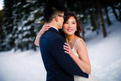 Asian American bride and her groom with makeup and hair design by Beauty on Location Studio of Denver, Colorado