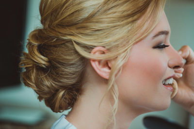 Closeup of Colorado bride with makeup and updo bridal hairstyle by Beauty on Location Studio of Denver