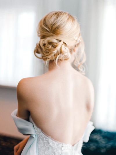Colorado bride with braided updo bridal hairstyle by Beauty on Location Studio of Denver