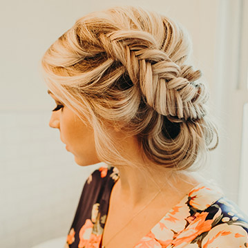 Colorado bride getting the finishes touches on her bridal updo with fishtail braid by Beauty on Location Studio