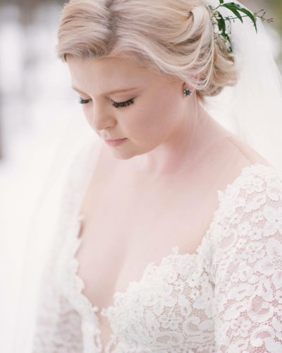 Colorado bride in lace gown with soft makeup and updo bridal hairstyle by Beauty on Location Studio of Denver